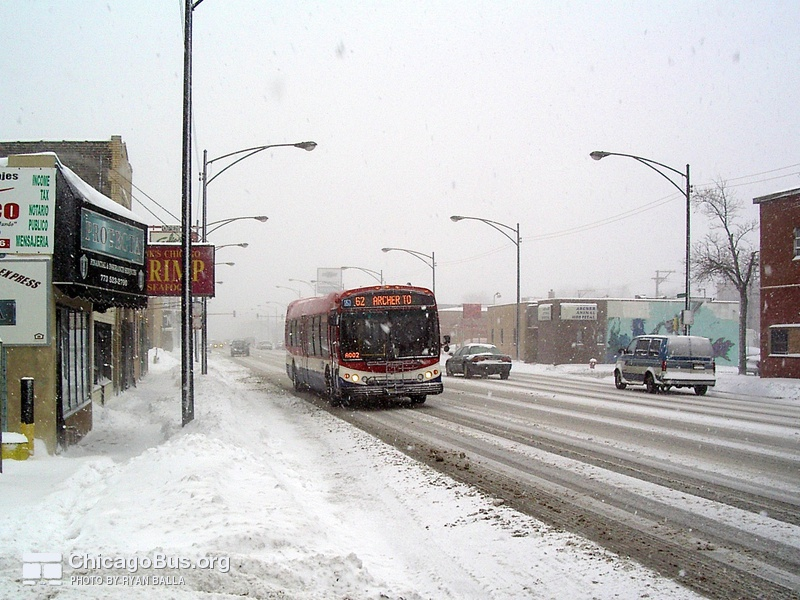 Prototype bus #7800 at Archer and Christiana working route #62 Archer on January 22, 2005.