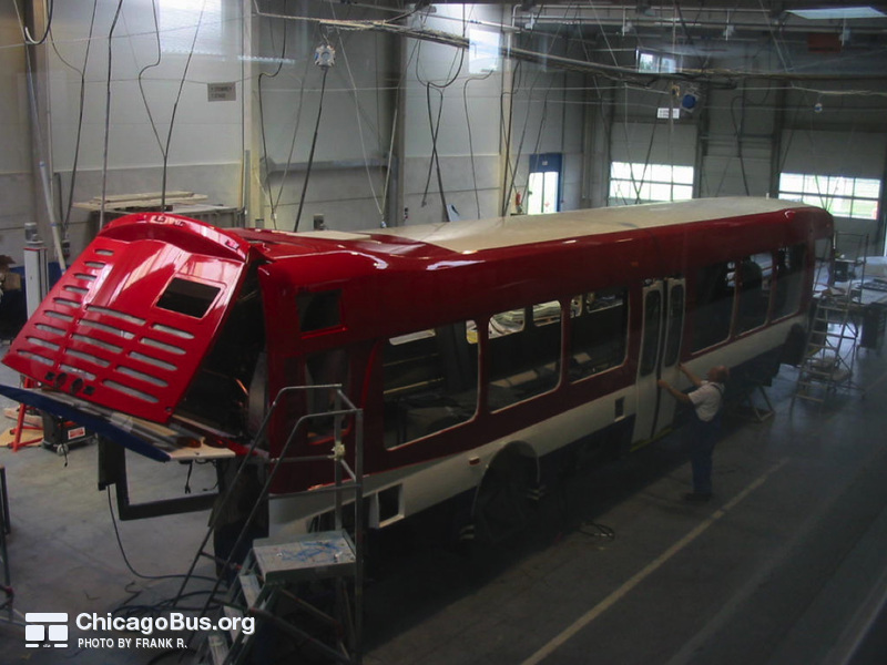 "NABI employees work on the assembly of CTA's NABI 45C-LFW CompoBus prototype in 2004 at the NABI plant in Anniston, AL. Special thanks to ""Family Guy"" for providing these rare assembly photos."