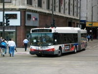 Bus #7501 at Washington and Michigan, working route #14 Jeffery Express, on April 28, 2004.
