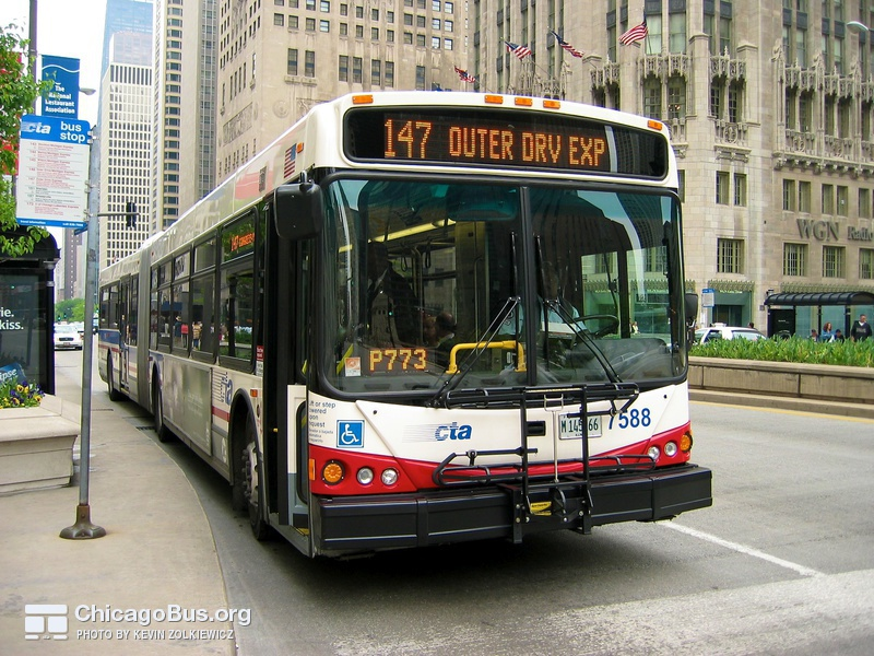 Bus #7588 at Michigan and Wrigley Building, working route #147 Outer Drive Express, on May 19, 2004.