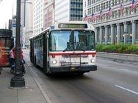 Bus #7324 at Michigan and Monroe, working route #6 Jackson Park Express, on August  5, 2003.