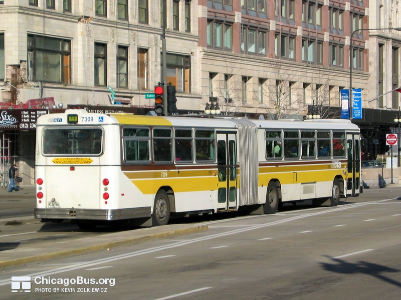 Bus #7309 at Michigan and Madison, working route #14 Jeffery Express, on November 26, 2003.