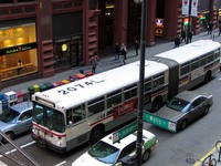 Bus #7396 at Jackson and Wells on March  9, 2004. Ex-King County Metro #2074.