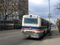 Bus #7402 at Foster and Marine, working route #147 Outer Drive Express, on March 11, 2004.