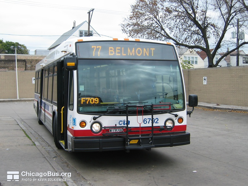 Bus #6792 at Belmont Blue Line Station, working route #77 Belmont, on October 23, 2003.
