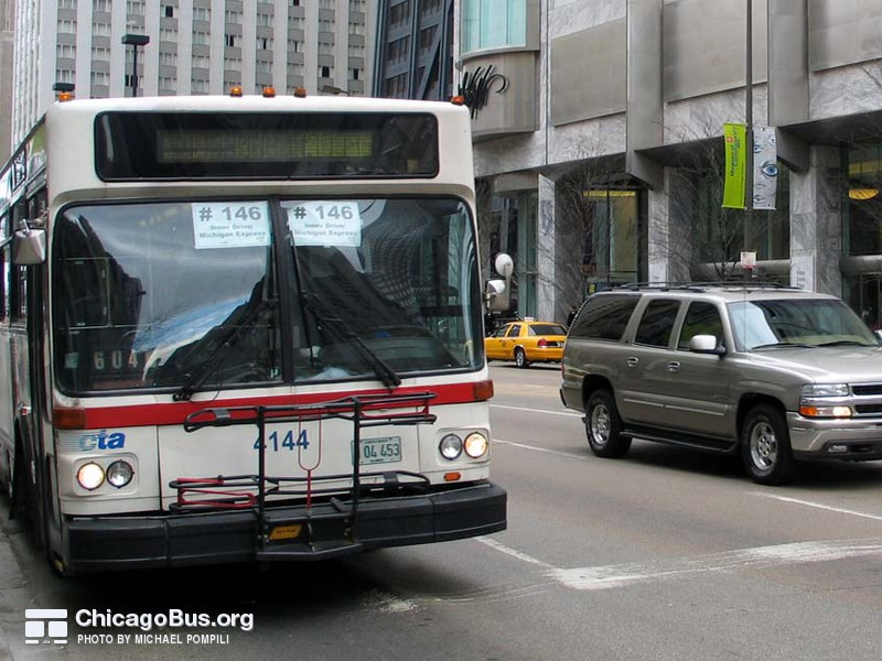 Bus #4144 at Michigan and Pearson, working route #146 Inner Drive/Michigan Express, on March 11, 2004.