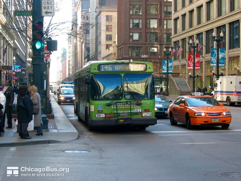 Bus #5811 at State and Washington, working route #146 Inner Drive/Michigan Express, on February 26, 2004.