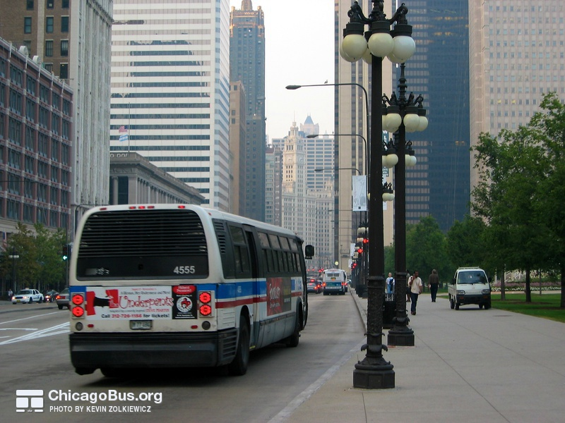 Bus #4555 at Michigan and Monroe, working route #143 Stockton/Michigan Express, on September 11, 2003.