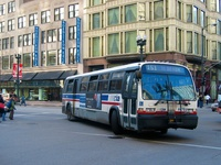 Bus #4476 at State and Washington, working route #151 Sheridan, on February 26, 2004.