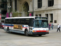 Bus #5554 at Michigan and Washington, working route #60 Blue Island/26th, on April 28, 2004. Note the missing bike rack.