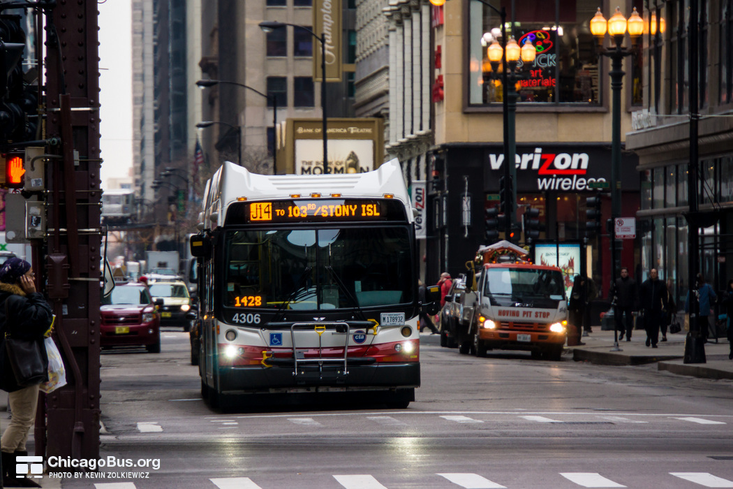 Bus #4306 at Monroe and Wabash, working route #J14 Jeffery Jump, on December 19, 2012.