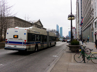 Bus #4306 at Michigan and Monroe, working route #J14 Jeffery Jump, on December 19, 2012.
