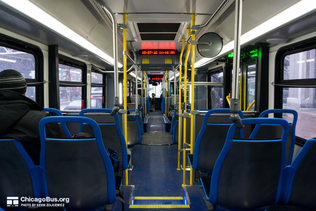The interior of bus #4333, working route #6 Jackson Park Express, on December 27, 2012. Unlike the previous order of articulated buses, the large majority of the seating on the 4300-series is forward-facing.