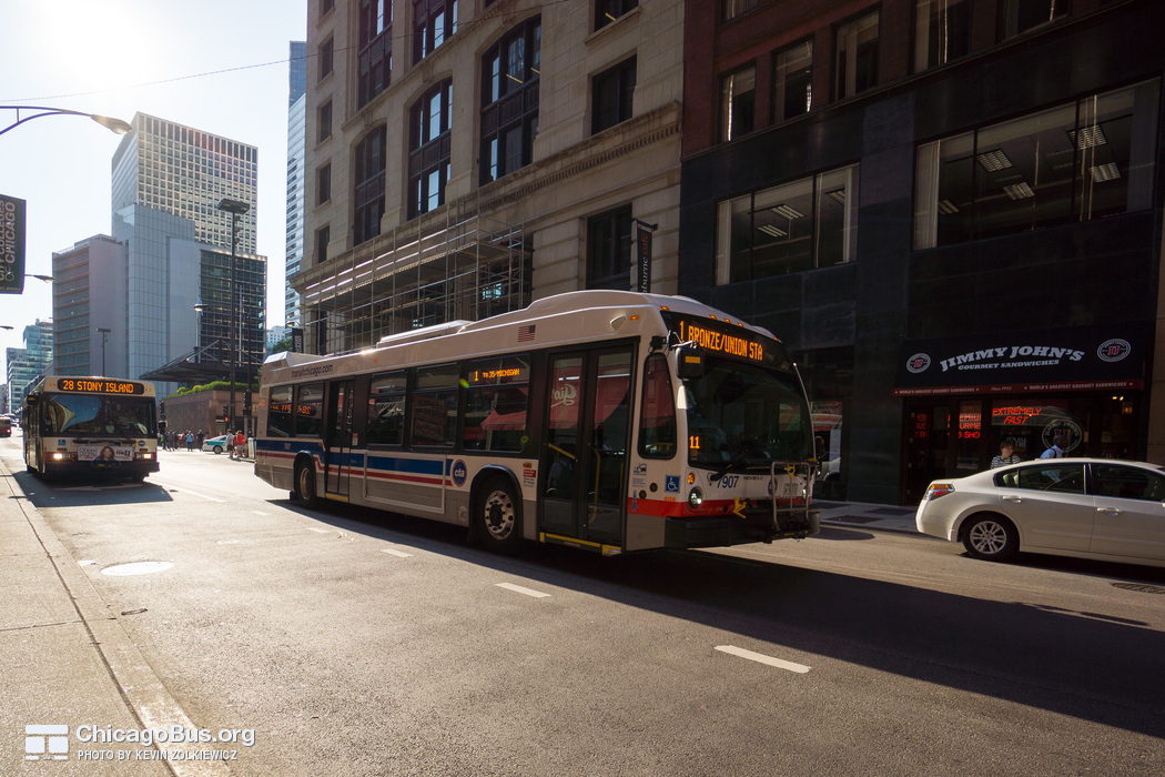 Bus #7907 at Jackson and Franklin, working route #1 Bronzeville/Union Station, on July 18, 2014.