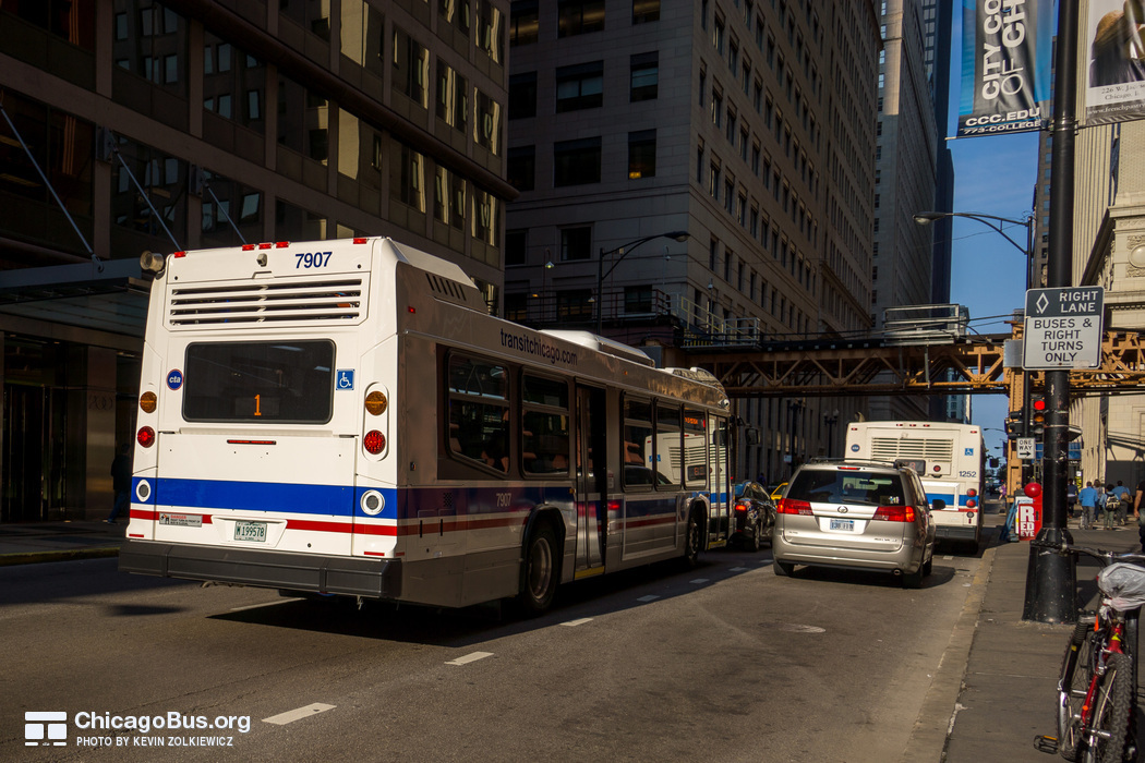 Bus #7907 at Jackson and Wells, working route #1 Bronzeville/Union Station, on July 18, 2014.
