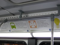 The interior of bus #4015, working route #147 Outer Drive Express, on December 13, 2008. Ad placards inside boasted about the features of the new hybrid buses.