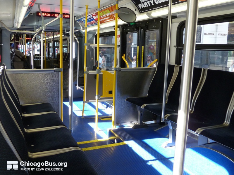 The interior of bus #4162 at State and Madison, working route #147 Outer Drive Express, on July 18, 2010. Numbers 4149-2207 switched to a longitudinal seating arrangement with Aries 4MA seats.