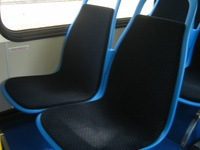"Prototype bus #1000 included eight ""Insight"" seats from American Seating. These new seats, which are wider and thiner than the previous generation of CTA seats, would be standard on future deliveries."