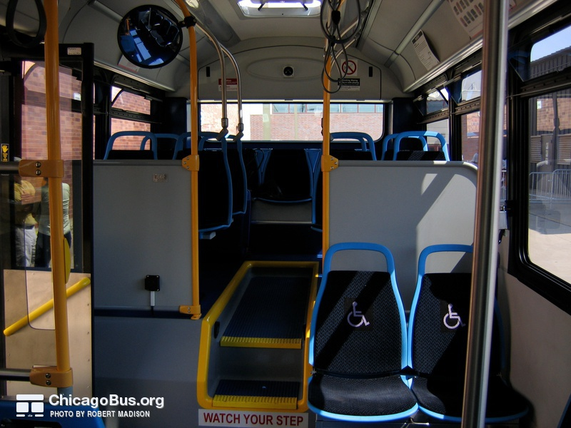 "The interior of prototype bus #500 while at Skokie Shops on June 17, 2006. Like the 1000-series New Flyers, the Optima Opus buses feature ""Insight"" seats from American Seating, wider and thiner than the previous generation of CTA seats."